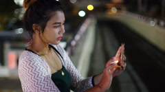 Young Thai Lady making selfie in night city 4k UHD (3840x2160) - stock footage