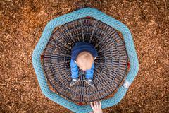 Little boy in a carousel - stock photo