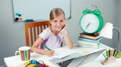 Portrait schoolgirl 7-8 years old something writing in notebook - stock footage