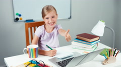 Portrait schoolgirl something writing in notebook and laughing at camera - stock footage