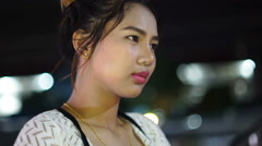 Portrait of young Thai Lady in night city 4k UHD (3840x2160) Stock Footage