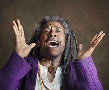 Exuberant African man with dreadlocks Stock Photos