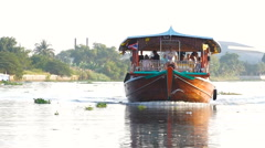Tourist boat travel along the river at Donwai floating market Stock Footage