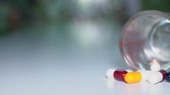 Close up of pills or caplets spinning on a table shot from above Stock Footage