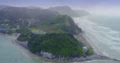 Aerial over beach in the fog at mangawhai heads, northland, new zealand Stock Footage