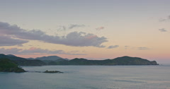 Timelapse of ocean at sunset in the Bay of Islands, Northland, New Zealand Stock Footage