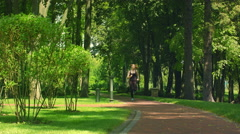Woman running in park. Fitness woman jogging outdoor. Runner training in park - stock footage
