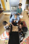 Black family watching chess game Stock Photos