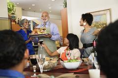 African American man serving Thanksgiving turkey Stock Photos