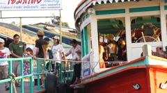 People getting out of boat trip at Donwai floating market Stock Footage