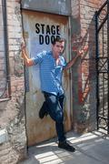 Stage door pose - stock photo