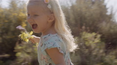 One child running and laughing Stock Footage