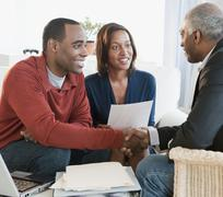 African American couple talking with financial advisor Kuvituskuvat
