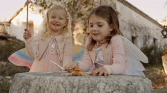 Two children playing with magic wands - stock footage