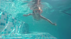 Father teaches a four-year daughter to swim under water Stock Footage
