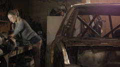Young woman working as mechanic in garage with tools Stock Footage