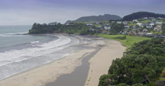 Aerial over beach in sandy bay, northland, new zealand Stock Footage
