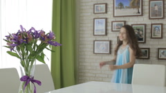 Beautiful girl rejoices donated bouquet of flowers - stock footage