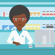 Pharmacist at counter with computer monitor Piirros
