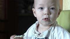 Baby eats and plays with buckwheat porridge 4k UHD (3840x2160) Stock Footage