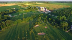 Scenic rural landscape with golf course, farms, homes, long shadows Stock Footage