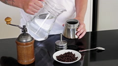 Man to make coffee on a black table Stock Footage