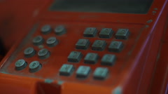 Dialing number on public phone in booth close-up 4k UHD (3840x2160) Stock Footage
