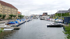 A canal in the Holmen livingarea in Copenhagen, where you see boats Stock Footage