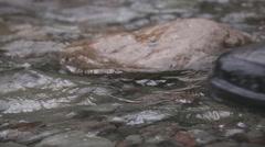 Fishing boot splashing in water - stock footage