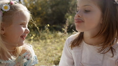 Two children playing together and making faces - stock footage