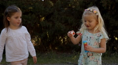 Two children playing with bubbles - stock footage