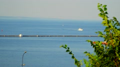 The yacht sails on the sea. On the horizon is visible city Stock Footage
