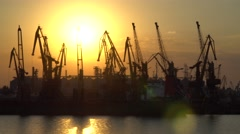Sunset on a background of cranes in the seaport Stock Footage
