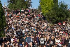 Many people in crowded park (Mauerpark) at  fete de la musique - stock photo