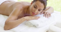 Naked woman relaxes on massage table - stock footage