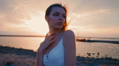 Portrait of a girl at sunset wide angle Stock Footage