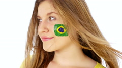 Girl with Brazil flag on her face smiling Stock Footage