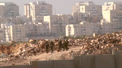 Israeli soldiers during Palestinian clashes in Bilin, West Bank Stock Footage