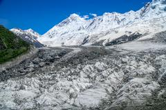 Massive glacier at the foot of Nanga Parbat mountain in the Karakorum range, Pak - stock photo