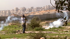 Teargas in Bilin in the West Bank, protests against the separation wall Stock Footage