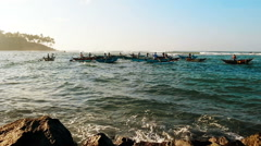 Fishing at sunrise, local fishermen floating in small boats in Indian ocean Stock Footage
