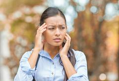 Stressed woman standing in park Stock Photos