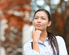 Young Businesswoman daydreaming, Thinking Kuvituskuvat