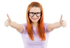 Happy woman giving thumbs up Stock Photos