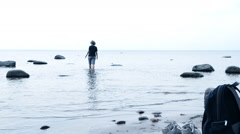 Woman walking on water Stock Footage