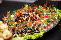 Catering services background with snacks and food in restaurant Stock Photos