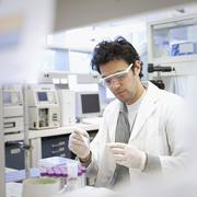 Middle Eastern scientist working in laboratory Stock Photos