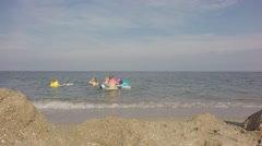 Group of children playing in the sea. - stock footage