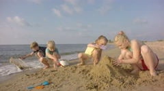 Sand Toys On The Beach. Children build sand. Slow motion. - stock footage