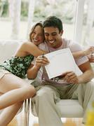 Couple hugging and holding certificate Stock Photos